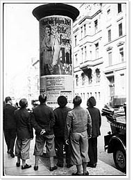 Photograph: Men looking at posters