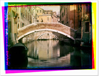 This image shows how three separate colour negatives form a single picture. Image of the Rio San Giacomo in Venice.